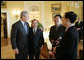 President George W. Bush meets with Chinese Human Rights activists Thursday, May 11, 2006, in the Yellow Oval Room of the White House. With the President, from left, are: Li Baiguang, Wang Yi, and Yu Jie. White House photo by Eric Draper