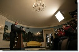 "President George W. Bush makes a brief statement to the nation Thursday, May 11, 2006, regarding the domestic surveillance program. Said the President, ""Our most important job is to protect the American people from another attack, and we will do so within the laws of our country."" White House photo by Eric Draper"