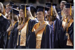 "A student stands for the playing of the national anthem during the commencement ceremonies at Mississippi Gulf Coast Community College in Biloxi, Miss., Thursday, May 11, 2006. ""You have sent a message and I came with a message of my own: This nation honors your dedication,"" said the President of the students' determination to graduate and help each other after Hurricane Katrina. ""We're inspired by your optimism, and we'll help this great state of Mississippi rebuild."" White House photo by Paul Morse"