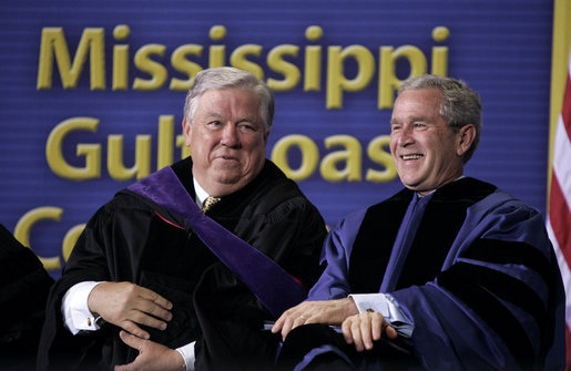 "President and Mississippi Governor Haley Barbour attend the 2006 graduation class at Mississippi Gulf Coast Community College in Biloxi, Miss., Thursday, May 11, 2006. ""You continued your studies in classrooms with crumbling walls. You lost homes, and slept in tents near campus to finish courses,"" said the President speaking about the students' experiences. ""You cleared debris during the day and you went to class at night."" White House photo by Paul Morse"