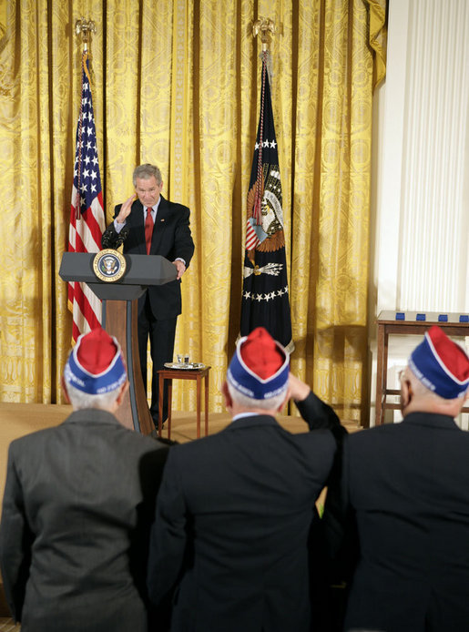 "President George W. Bush salutes veterans during an event celebrating Asian Pacific American Heritage Month in the East Room Friday, May 12, 2006. ""These men and women are on the front line of defending the United States of America, and in so doing, they're laying the foundation of peace for generations to come. And we're really proud of your service,"" said the President. White House photo by Paul Morse"