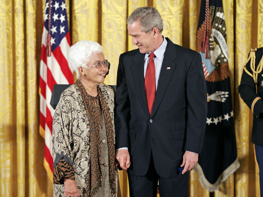 President George W. Bush and Virginia Ganzon-Sturwold of San Francisco exchange glances during the presentation of the President's Volunteer Service Award during a celebration of Asian Pacific American Heritage Month in the East Room Friday, May 12, 2006. White House photo by Paul Morse