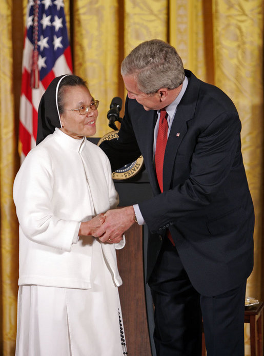 "President George W. Bush awards Sister Theresa Pham of Houston with the President's Volunteer Service Award during an event celebrating Asian Pacific American Heritage Month in the East Room Friday, May 12, 2006. ""I created this award because I understand the great strength of the United States of America is not found in our military, and it's certainly not because of the size of our wallets, it's because the strength of America is found in the hearts and souls of generous citizens who answer to a universal call to love a neighbor like you'd like to be loved yourself,"" said the President White House photo by Paul Morse"
