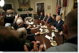 "President George W. Bush talks with the press after discussing Iraq with former Secretaries of State and Defense in the Roosevelt Room Friday, May 12 ,2006. ""Since we last met, a unity government is now in the process of becoming formed. I've got great hopes about this unity government,"" said the President. ""We've got a Shia as the Prime Minister-designee, a Sunni as the Speaker, a Kurd as the President, all of whom have dedicated themselves to a country moving forward that meets the hopes and aspirations of the Iraqi people."" White House photo by Eric Draper"