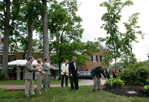 President George W. Bush and Australian Prime Minister John Howard participate in the presentation of White House trees at the Australian Ambassador's Residence, Sunday, May 14, 2006. White House photo by Eric Draper