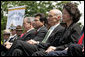 President George W. Bush sits with, from left, Attorney General Alberto Gonzales, Homeland Security Secretary Michael Chertoff and Labor Secretary Elaine Chao during the Annual Peace Officers' Memorial Service at the U. S. Capitol Monday, May 15, 2006. White House photo by Kimberlee Hewitt