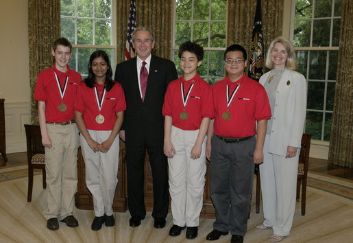 President George W. Bush stands with Top Team members of the MATHCOUNTS National Competition Monday, May 15, 2006, in the Oval Office of the White House. From left are: Jimmy Clark, 13, Falls Church, Va.; Divya Garg, 13, Annadale, Va.; President Bush; Brian Hamrick, 14, Annandale, Va.; Daniel Li, 14, of Fairfax, Va., and Barbara Burnett, Coach of the National Champion Team from Falls Church. White House photo by Paul Morse