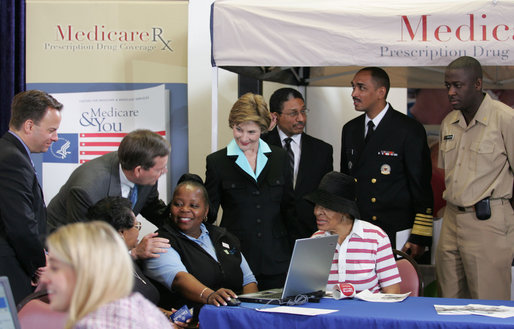 Mrs. Laura Bush meets with senior citizens during the last day of enrollment for the new Medicare prescription drug benefit at Shiloh Baptist Church in Washington, D.C., Monday, May 15, 2006. Talking with senior citizens with Mrs. Bush is Dr. Mark McClellan, Administrator, Centers of Medicare and Medicaid, and Secretary Mike Leavitt, Department of Health and Human Services. White House photo by Shealah Craighead