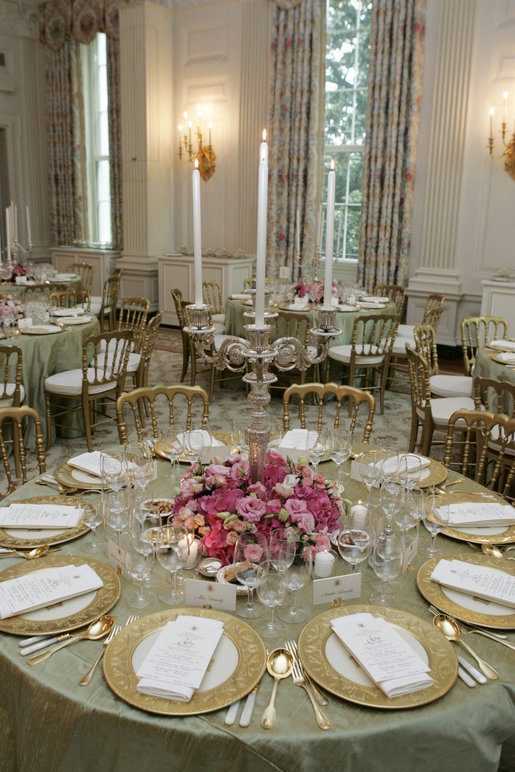 The dinner tables are set and decorated in the State Dining Room of the White House, Tuesday, May 16, 2006, for the official dinner to honor Australian Prime Minister John Howard and his wife Janette Howard. White House photo by Shealah Craighead