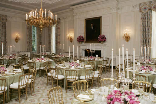 A portrait of President Abraham Lincoln is seen in the State Dining Room of the White House, as tables are set and decorated Tuesday, May 16, 2006, for the official dinner to honor Australian Prime Minister John Howard and his wife Janette Howard. White House photo by Shealah Craighead