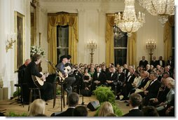 President George W. Bush, Mrs. Laura Bush and their invited guests listen to country singer Kenny Chesney perform in the East Room of the White House Tuesday evening, May 16, 2006, at the official dinner for Australian Prime Minister John Howard and Mrs. Janette Howard. White House photo by Paul Morse
