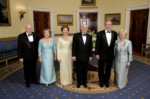 President George W. Bush, Laura Bush, Vice President Dick Cheney and Lynne Cheney stand with Australian Prime Minister John Howard and his wife Mrs. Janette Howard in the Blue Room for a photograph during the official dinner Tuesday, May 16, 2006. White House photo by Paul Morse