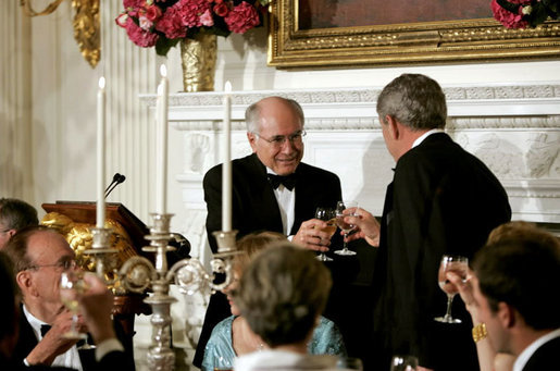 President George W. Bush and Prime Minister John Howard of Australia exchange toasts during an official dinner in the State Dining Room Tuesday, May 16, 2006. White House photo by Paul Morse