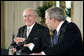 Prime Minister John Howard of Australia smiles at President Bush during their joint press conference in the East Room Tuesday, May 16, 2006. White House photo by Paul Morse