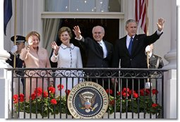 President George W. Bush, Prime Minister John Howard, Mrs. Laura Bush and Mrs. Janette Howard wave from the South Portico of the White House during the State Arrival Ceremony on the South Lawn Tuesday, May 16, 2006. White House photo by Paul Morse