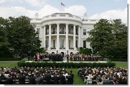 President George W. Bush speaks to an audience on the South Lawn Wednesday, May 17, 2006, during a signing of H.R. 4297, Tax Relief Extension Reconciliation Act of 2005. White House photo by Kimberlee Hewitt