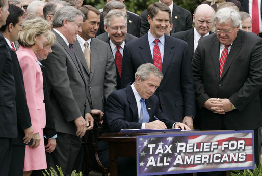 President George W. Bush signs H.R. 4297, the Tax Relief Extension Reconciliation Act of 2005, during bill-signing ceremonies Wednesday, May 17, 2006, on the South Lawn. White House photo by Paul Morse