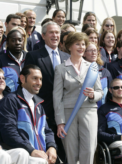 President George W. Bush and Laura Bush, seen holding an Olympic torch, pose with the 2006 U.S. Winter Olympic and Paralympic teams during a congratulatory ceremony held on the South Lawn at the White House Wednesday, May 17, 2006. White House photo by Eric Draper