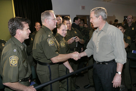 President George W. Bush greets U.S. Border Patrol agents after delivering remarks on border security and immigration reform at the U.S. Border Patrol Yuma Sector Headquarters in Yuma, Arizona, Thursday, May 18, 2006. White House photo by Eric Draper