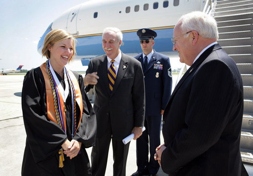 Upon landing in Louisana, Vice President Dick Cheney talks with Louisiana State University Student Body President Michelle Gieg and Chancellor Sean O'Keefe alongside Air Force Two. The vice president delivered the commencement address to over 3,000 bachelors, masters, and doctoral students. White House photo by David Bohrer