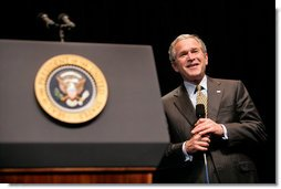 President George W. Bush reacts while taking questions from the audience Monday, May 22, 2006, following his remarks on the War on Terror to the National Restaurant Association gathering at Chicago's McCormick Place.  White House photo by Eric Draper