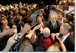 President George W. Bush greets the audience, Monday, May 22, 2006, following his remarks on the War on Terror to the National Restaurant Association gathering at Chicago's McCormick Place. White House photo by Eric Draper