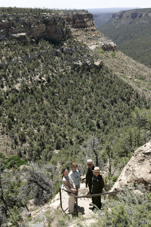Mrs. Laura Bush pauses for a photo while hiking in Mesa Verde National Park in Colorado with, from left, Lynn Scarlett, Acting Secretary of the U.S. Department of Interior, Fran Mainella, Director, National Park Service and Larry Wiese, Superintendent of Mesa Verde National Park on Tuesday, May 23, 2006. Mesa Verde, founded as a national park on June 29, 1906, is celebrating its Centennial Anniversary this year. White House photo by Shealah Craighead