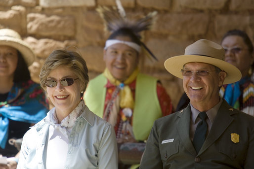 Mrs. Laura Bush and Mesa Verde National Park Superintendent Larry Wiese share a laugh, Thursday, May 23, 2006, during the celebration of the 100th anniversary of Mesa Verde and the Antiquities Act in Mesa Verde, Colorado. Also pictured are members of the Ute Mountain Ute Tribe. White House photo by Shealah Craighead