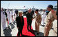 Vice President Dick Cheney and his wife Lynne Cheney is greeted by officers from the amphibious assault ship USS Bonhomme Richard. The vice president spoke to over 4,000 sailors and Marines and thanked them and their families for their service to the country. White House photo by David Bohrer