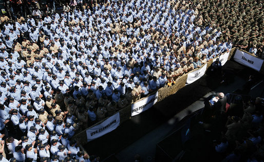 Some of the over 4,000 sailors and Marines gather aboard the USS Bonhomme Richard as they watch and listen to Vice President Dick Cheney as he praised the men and women of Expeditionary Strike Group 1 for their humanitarian relief work following the earthquake in Pakistan and the tsunami in South Asia. White House photo by David Bohrer