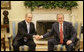 President George W. Bush exchanges handshakes with Prime Minister Ehud Olmert of Israel during their meeting Tuesday, May 23, 2006, in the Oval Office. White House photo by Eric Draper