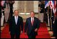 President George W. Bush walks through the Cross Hall with Prime Minister Ehud Olmert of Israel to a joint press conference in the East Room Tuesday, May 23, 2006. White House photo by Kimberlee Hewitt