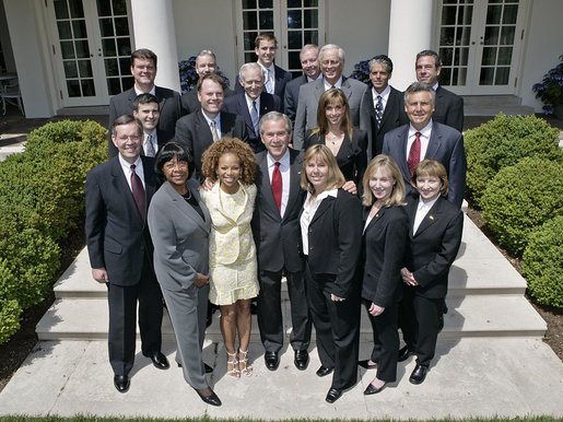 President George W. Bush stands with the President's Council on Physical Fitness and Sports in the Rose Garden Wednesday, May 24, 2006 at the White House. From left to right-front row:U.S. Secretary of Health and Human Services, Michael O. Leavitt; Dr. Lillian Green-Chamberlin; Donna Richardson Joyner; Dr. Dorothy Richardson; Melissa Johnson and Dr. Cathy Baase. Row Two: William Greer; John Burke; Charles Moore; Susan Dell and Kirk Bauer. Row Three: Tedd Mitchell; Dr. Ed Laskowski; Eli Manning; Jerry Noyce; Edgar Weldon; Paul Carrozza and Steve Bornstein. White House photo by Eric Draper