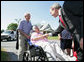 President George W. Bush meets with residents during a surprise stop in a Pottstown, Pa., neighborhood Wednesday, May 24, 2006 , after his visit to the nearby Limerick Generating Station in Limerick, Pa. White House photo by Kimberlee Hewitt