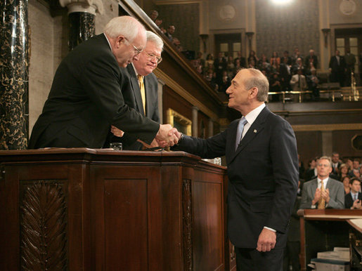 Vice President Dick Cheney congratulates Prime Minister Ehud Olmert of Israel, Wednesday, May 24, 2006, following the prime minister's remarks to a Joint Meeting of Congress at the U.S. Capitol. White House photo by David Bohrer