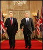 "President George W. Bush and Prime Minister Tony Blair of Great Britain, walk through Cross Hall en route to the East Room Thursday night, May 25, 2006, for a joint press availability during which the President said of Iraq's new government, ""The United States and Great Britain will work together to help this new democracy succeed."" White House photo by Shealah Craighead"