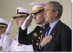President George W. Bush participates in the Change of Command Ceremony for the Commandant of the U.S. Coast Guard Thursday, May 25, 2006. He stands onstage with General Peter Pace, Chairman, Joint Chiefs of Staff, and Admiral Thad Allen, the 23rd Commandant. White House photo by Eric Draper