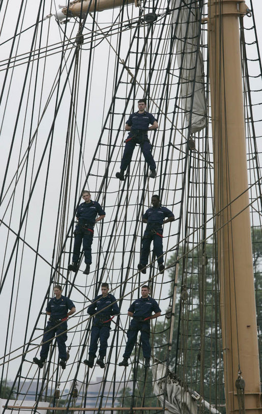 Crew members of the USCGC Eagle stand on the tall ship's rigging Thursday, May 25, 2006, near Fort Lesley J. McNair in Washington, D.C., during the Change of Command Ceremony for the Commandant of the United States Coast Guard. White House photo by Eric Draper