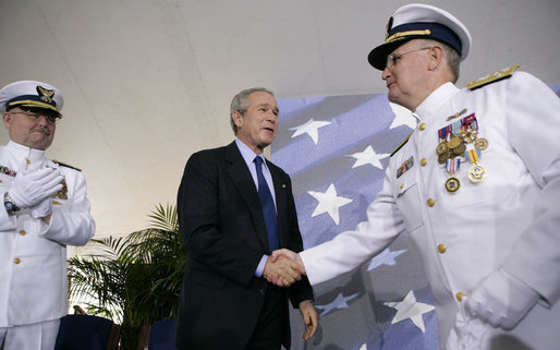 President George W. Bush congratulates Admiral Tom Collins for his 38 years of service in the U.S. Coast Guard, including the last four as Commandant, during the U.S. Coast Guard's Change of Command Ceremony Thursday, May 25, 2006, at Fort Lesley J. McNair in Washington, D.C. Looking on is Admiral Collins' successor, Admiral Thad Allen. White House photo by Eric Draper