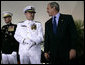President George W. Bush smiles as he talks with Admiral Thad Allen, Commandant of the U.S. Coast Guard, on stage at Fort Lesley J. McNair in Washington D.C., during a Change of Command Ceremony Thursday, May 25, 2006. White House photo by Eric Draper