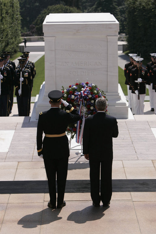 President George W. Bush stands with U.S. Army Major General Guy Swan for a moment of silence during the Memorial Day wreath laying ceremony at the Arlington National Cemetery Tomb of the Unknowns in Arlington, Va., Monday, May 29, 2006. White House photo by Paul Morse