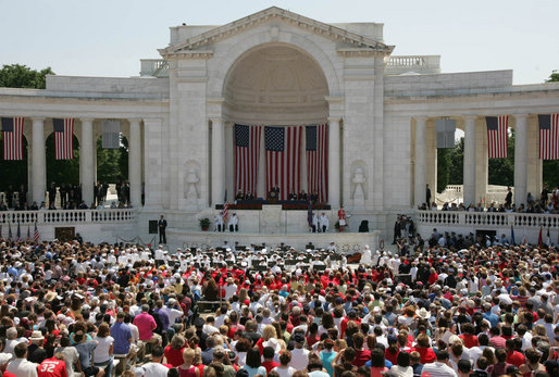 President George W. Bush addresses the thousands of people who gathered to pay their respects on Memorial Day at the Arlington National Cemetery amphitheatre in Arlington, Va., Monday, May 29, 2006. White House photo by Shealah Craighead