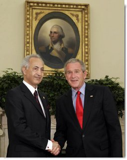 President George W. Bush exchanges handshakes with Samir Sumaidaie, Iraq's Ambassador to the United States, after receiving his credentials during an Oval Office ceremony Tuesday, May 30, 2006. Ambassador Sumaidaie is the first ambassador of a freely-elected, democratic Iraqi Government in decades.  White House photo by Paul Morse