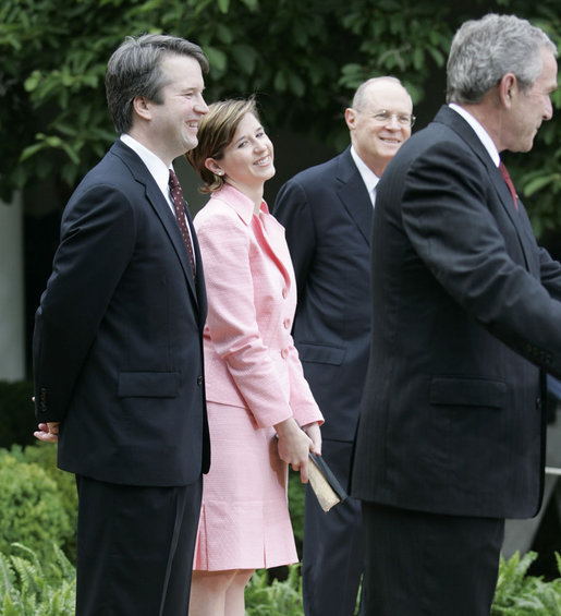 Brett and Ashley Kavanaugh and Justice Anthony Kennedy react to President George W. Bush during the Rose Garden swearing-in ceremony Thursday, June 1, 2006, for Mr. Kavanaugh to the U.S. Court of Appeals for the District of Columbia. White House photo by Eric Draper