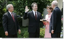 President George W. Bush looks on as Justice Anthony Kennedy swears in Brett Kavanaugh to the U.S. Court of Appeals for the District of Columbia during a ceremony Thursday, June 1, 2006, in the Rose Garden. Mrs. Ashley Kavanaugh holds the Holy Bible. White House photo by Eric Draper