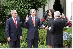 "President George W. Bush attends the swearing-in ceremony of Rob Portman as the Director of the Office of Management and Budget in the Rose Garden Friday, June 2, 2006. Director Portman's wife Jane Portman hold the bible as White House Chief of Staff Joshua Bolten administers the oath. ""The OMB Director is a critical member of my Cabinet,"" said the President. He plays a vital role in every aspect of my administration's agenda, from securing the homeland, to winning the war on terror, to growing our economy and creating jobs."" White House photo by Eric Draper"