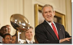 President George W. Bush stands next to the Super Bowl Trophy as he welcomes the Super Bowl Champion Pittsburgh Steelers to the White House, Friday, June 2, 2006, during a ceremony in the East Room to honor the Super Bowl champs. White House photo by Eric Draper