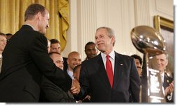 President George W. Bush shakes hands with Pittsburgh Steelers coach Bill Cowher, as he welcomes the Super Bowl Champion Pittsburgh Steelers to the White House, Friday, June 2, 2006, during a ceremony in the East Room to honor the Super Bowl champs. White House photo by Eric Draper