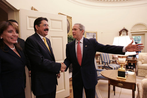 "President George W. Bush welcomes President Manuel Zelaya and First Lady of Honduras, Xiomora Zelaya, to the Oval Office Monday, June 5, 2006. ""We've had a very good discussion, as you would expect amongst friends,"" said President Bush. ""We discussed our common interests, and one of our common interests is expanded commercial opportunity. And CAFTA gives us a chance to realize those opportunities. We talked about our common desire to make sure the democracies in the region are strong."" White House photo by Eric Draper"