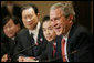 President George W. Bush shares a humorous exchange with members of the Chinese Leadership Program Fellows, Monday, June 5, 2006 at the Eisenhower Executive Office Building in Washington. White House photo by Eric Draper